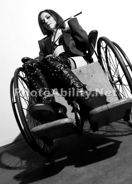 Women posing in vintage wheelchairs