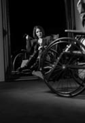 Women posing in vintage wheelchairs