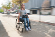 Young-woman-speeding-in-her-wheelchair