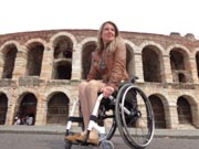 Young-woman-traveler-using-wheelchair-touring-Italy