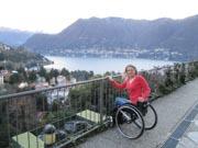 Woman-tourist-using-wheelchair-overlooking-Lake-Como,-Italy