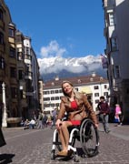 Woman-tourist-using-wheelchair-in-Innsbruck,-Austria