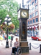 Male-tourist-in-wheelchair-at-Vancouvers-Steam-Clock