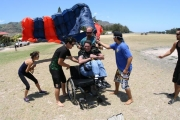 Man-in-his-wheelchair-after-his-parachute-jump