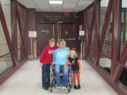 Young-mother-in-wheelchair-with-her-children