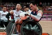 CHUCK-AOKI-USA-5-takes-KAZUHIKO-KANNO-JPN-6-by-surprise-and-out-maneuvers-for-goal-in-the-mens-wheelchair-rugby-bronze-game-at-the-2012-Paralympic-Games.