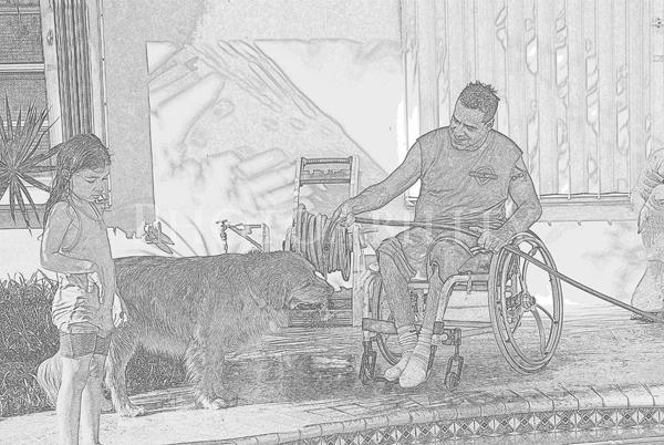 Man in a wheelchair with his daughter and dog