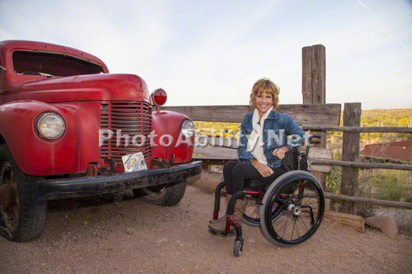 Woman using a wheelchair exploring an historic outdoor museum