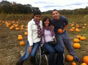 Mother-in-wheelchair-in-a-pumpkin-patch-with-her-family