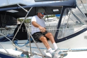 Sailor-in-wheelchair-with-his-yacht-at-the-dockMature-man-in-wheelchair-boarding-his-yacht