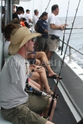 Double-arm-amputee-man-fishing-on-charter-boat