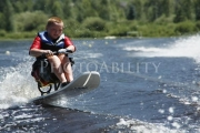 wheelchair;disabled;disability;access;accesible;inclusion;inclusive;leisure;travel;lake;water;skiing;child;boy