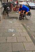 Man-using-wheelchair-exploring-Amsterdam