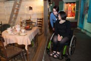 Young-woman-in-wheelchair-discovering-museum