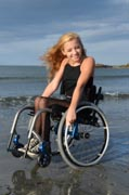 Young-woman-in-wheelchair-on-beach