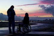 Woman-in-wheelchair-at-sunset