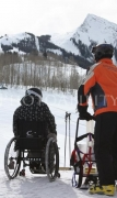 wheelchair;woman;female;skiing;sit-ski;disabled;disability;snow;mountains;sun;rockies;colorado