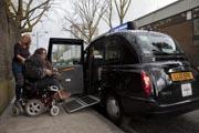 Female-tourist-in-London-using-power-wheelchair