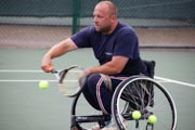 Disabled-man-playing-wheelchair-tennis-in-an-adapted-wheelchair-at-the-Nottingham-tennis-centre,
