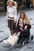 Carer-and-young-woman-with-Cerebral-Palsy-shopping,