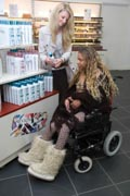 Carer-and-young-woman-with-Cerebral-Palsy-shopping-choosing-shampoo,