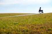 Woman-in-wheelchair-on-country-hilltop