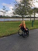 Woman-in-wheelchair-out-for-stroll-around-lake
