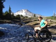 Woman-in-wheelchair-on-mountain-hiking-trail