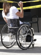 wheelchair;woman;female;street;streetscape;city