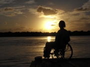 wheelchair;woman;female;beach;ocean;water;sunset
