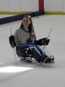 wheelchair;woman;female;ice;winter;hockey;sled-hockey