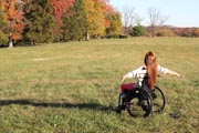 Young-woman-in-wheelchair-in-park-during-Fall