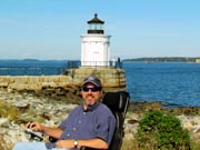 Man-in-power-chair-on-enjoying-coastal-scenery