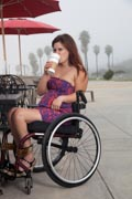 Woman-using-wheelchair-having-coffee-at-the-beach