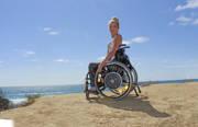 Woman-using-wheelchair-at-the-ocean