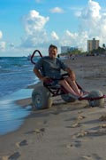 Man-enjoying-the-ocean-in-beach-wheelchair