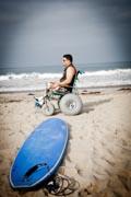 Man-in-beach-wheelchair-on-an-ocean-beach