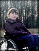 Young-woman-in-wheelchair-in-forest