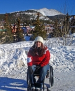 wheelchair;female;woman;access;accessibility;inclusive;snow;skiing;sun;alps;mountain;sit-ski;breckenridge