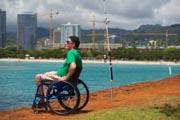 Man-in-wheelchair-beach-fishing-in-Hawaii