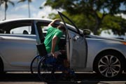 Young-man-in-wheelchair-getting-into-his-car