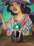 Man-in-wheelchair-taking-in-street-art
