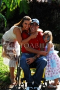 Man-in-wheelchair-with-his-wife-and-daughter