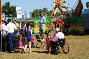 Man-in-wheelchair-with-his-daughter-at-an-Easter-Fun-Fair