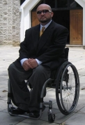 Man-in-wheelchair-waiting-outside-church