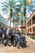 Young-couple-in-wheelchairs-at-an-outdoor-shopping-mall