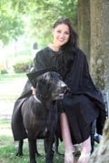 Young-woman-in-wheelchair-at-her-graduation-with-her-service-dog