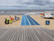 St-Kilda,-Melbourne,-Australia.-9-Dec,-2017.-St-Kilda-is-now-home-to-Australia-s-most-accessible-beach,-following-Port-Phillip-Councils-launch-there-today-of-beach-wheelchairs-and-matting-to-ensure-people-with-disabilities-can-enjoy-day-at-the-Bay.