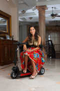 Young-fashion-model-using-mobility-scooter-on-shoot