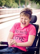 Portrait-Of-Disabled-Girl-Laughing-Sitting-On-Wheelchair